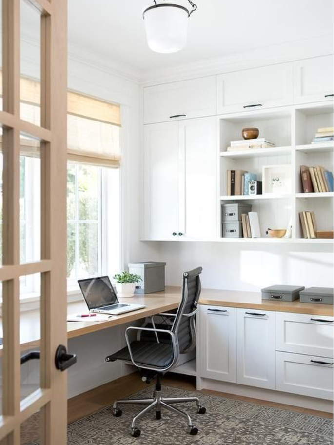 home office with brown desk and white cabinets