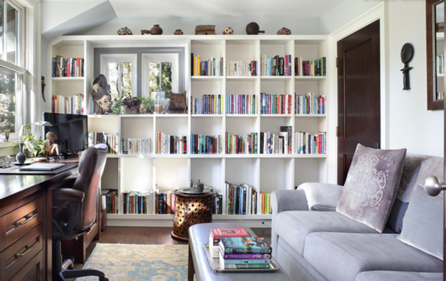 home office with bookshelves and couch
